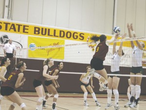 Flying High: Senior Sarah Lark spikes the ball over opponents during a recent game.  The volleyball team will travel to Indianapolis on the 19th for the first round of NCAA D-II Midwest Region games. Photo By: Kate Dupon   Photgrapher