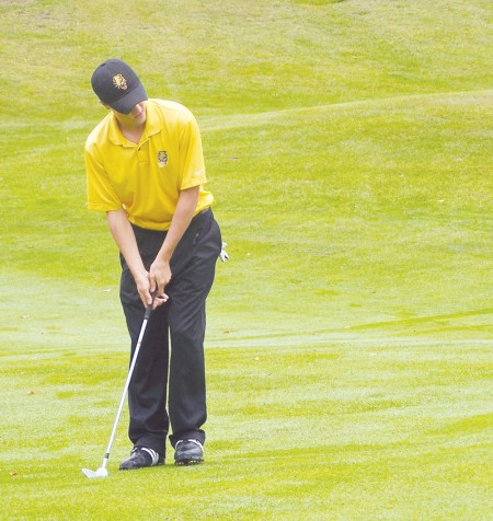 Swinging Ahead: Former Ferris golfer, Eric Lilleboe, analyzes a shot on the green during his warm-up. Lilleboe qualified for the U.S. Amateur Championship at Chambers Bay in University Place, Wash. and also co-medaled at the U.S. Amateur Qualifer in Harbor Springs. Torch File Photo