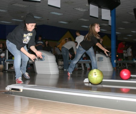 """Bowling for Kids: Nicole Allen, left, and Samantha Evans, right, bowl during the Big Brother Big Sisters """"Bowl for Kids' Sake"""" at the Gate. The event was a fundraising opportunity that took place on March 22-23 and raised $6,000. Photo By: Kate Dupon 