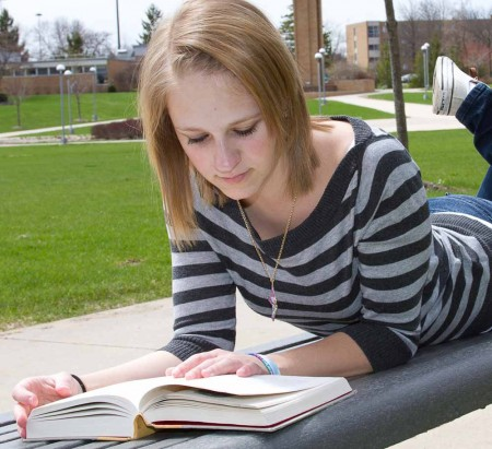 Leisure Reading: Marissa Basty reads Harry Potter during a study break. Students can use the summer to catch up on all their favorite reading. Photo By: Brock Copus | Web Editor