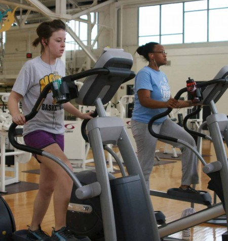 Shape Up: Samantha Krause and Keisha Reynolds, above, work out at the University Recreation Center. The URec is just one of many places students can work out during the summer in Big Rapids. Photo By: Kate Dupon | Photo Editor