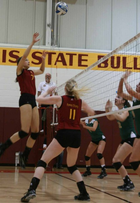 On to Regionals: FSU junior middle hitter Anne Sutton and junior setter Samantha Fordyce work together during the quarterfinal matchup against Wayne State University. The Bulldogs will play Saginaw Valley on Nov. 18 in the Midwest Regional Quarterfinals. Photo By: Kate Dupon | Photo Editor