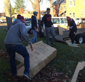 Participants volunteered at the Salvation Army in Big Rapids, moving and breaking down cardboard boxes to be recycled.