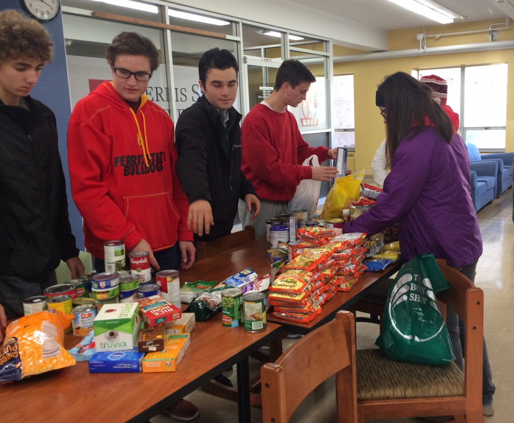 The yellow tribe unloads some of the non-perishable food items that they collected to go to the Manna Pantry downtown.