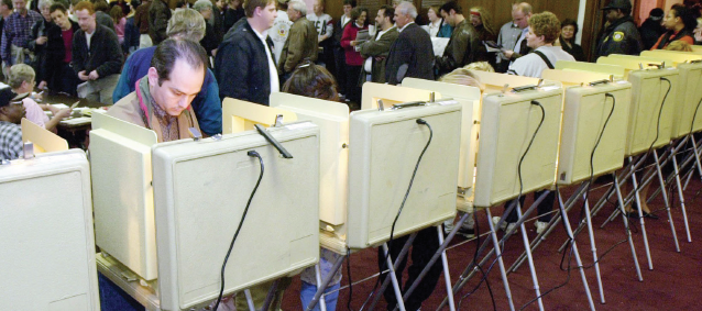 Citizens cast their votes at private polling booths. Michigan's caucus is scheduled for March 8.